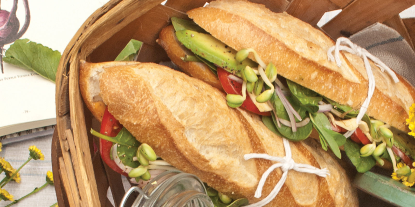 Baguette sandwiches in a picnic basket