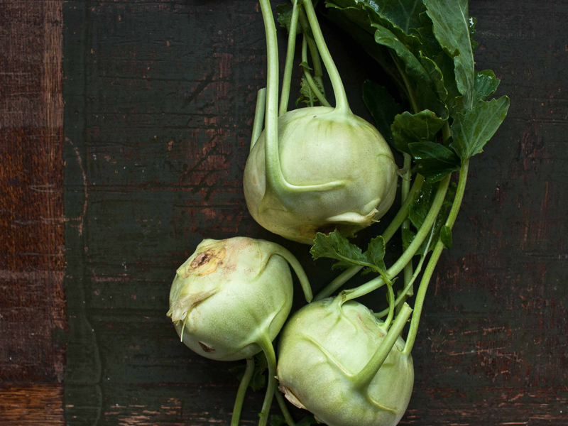 three bulbs of green kohlrabi